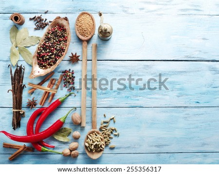 Different spices on old wooden table. - stock photo