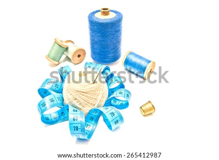 different spools of thread and yarn on white background closeup - stock photo