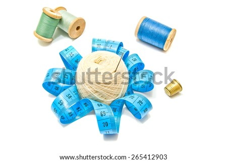 different spools of thread and yarn on white closeup - stock photo