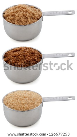Different sugars - light brown soft or muscovado, dark brown soft or muscovado and demerara - in cup measures, isolated on a white background - stock photo