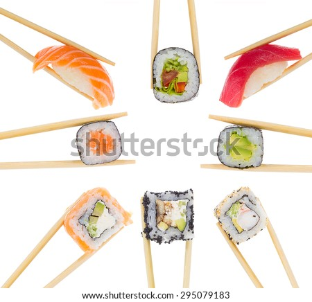 Different sushi and rolls in chopsticks isolated on whit background - stock photo