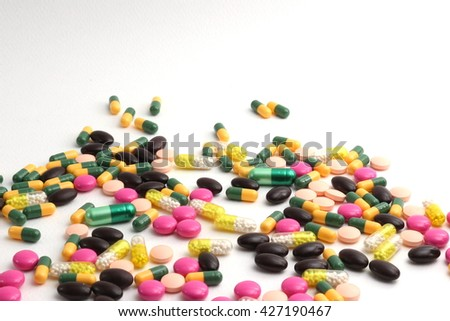 different Tablets mix heap drugs pills capsules therapy doctor flu antibiotic pharmacy medicine medical  - stock photo