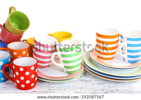 Different tableware on shelf, isolated on white - stock photo