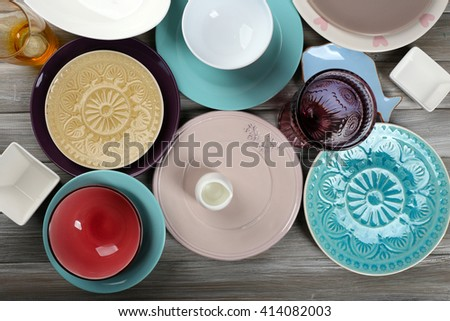 Different tableware on wooden table close up - stock photo