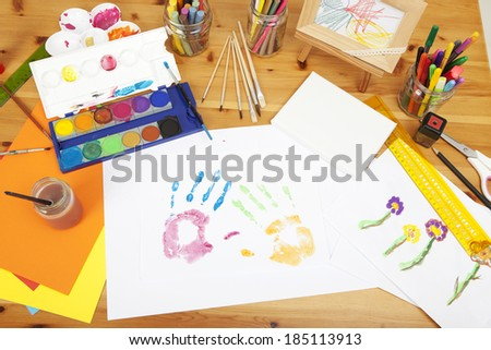 different things lying on a table to try arts and crafts, painted by kids - stock photo