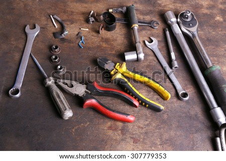 Different tools on workplace in garage - stock photo