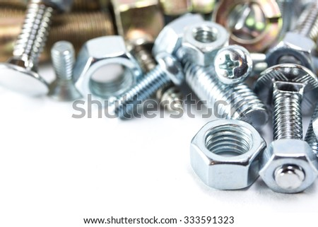 Different type of bolt and nut isolated on white background - stock photo