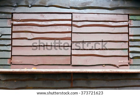 Different type of wooden window guard mounted on lodge cabin - stock photo
