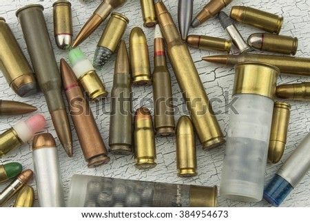 Different types of ammunition. Bullets of different calibers and types. The right to own a gun. Sales of weapons and ammunition. - stock photo