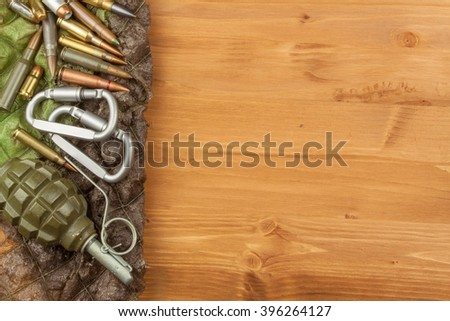 Different types of ammunition on a wooden background. Grenade and bullets. Arms trade. - stock photo