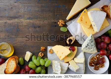 Different types of cheeses with empty space background. Top view - stock photo
