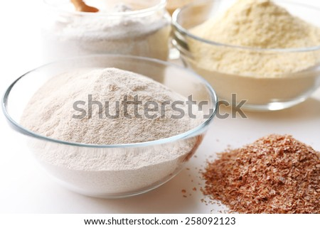 Different types of flour in bowls close up - stock photo
