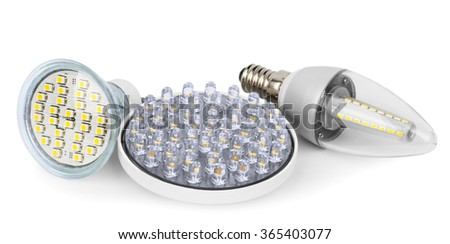 Different types of LED lamps: LED lightbulb GU10 base, LED light candle E14 base, LED light spot GX53 base. Photo has clipping path. - stock photo