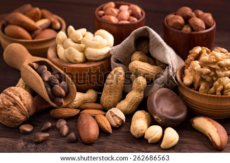 Different types of nuts: walnut, hazelnut, cashew, peanuts; brazil nuts, pine nuts and other - stock photo