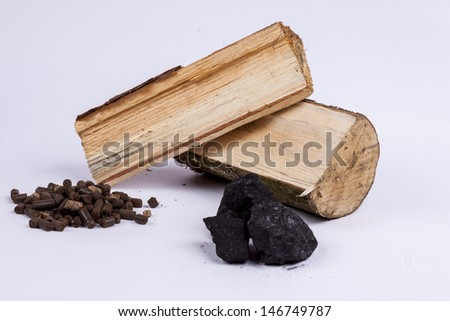 different types of plant-derived fuel: coal, wood, pellets from ligno cellulose - stock photo