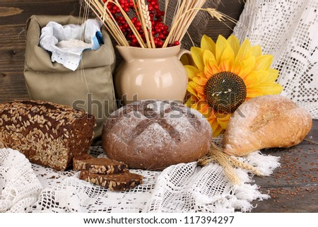 Different types of rye bread on wooden table on autumn composition background - stock photo