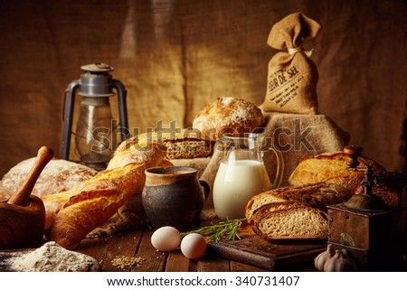 Different types of rye bread on wooden table on composition background - stock photo