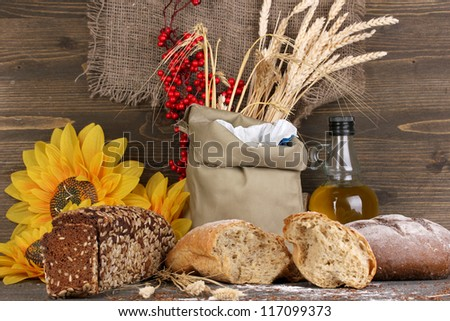 Different types of rye bread on wooden table on wooden background - stock photo