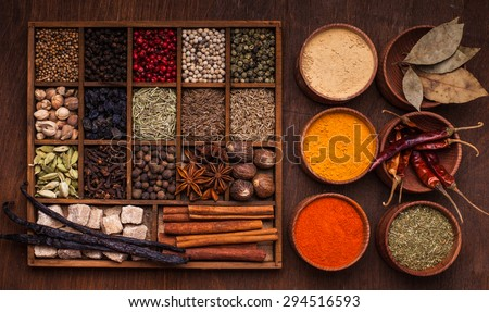 Different types of spices in wooden box - stock photo