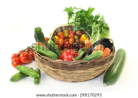 different types of vegetables in a basket - stock photo