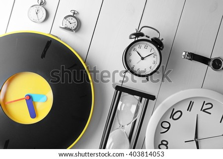 Different types of watches on white background. - stock photo
