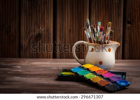 Different used brushes, colours and watercolours - stock photo