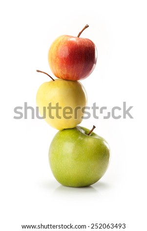 different varieties of apples isolated on white background - stock photo