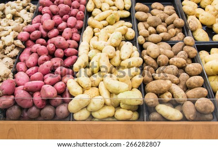 Different varieties of potatoes in a shelf in a grocery store - stock photo