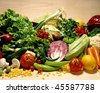 Different vegetables on maple wood background - stock photo