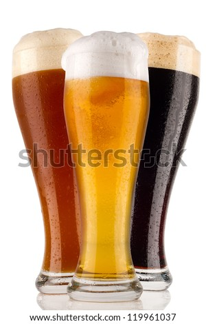 different wheat beer in front of white background - stock photo