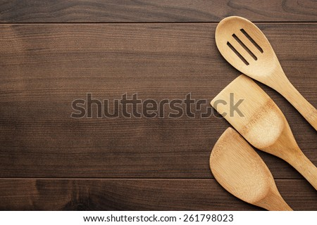 different wooden kitchen tools on the table with copy space - stock photo