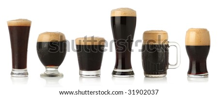 Differente glasses of stout beer, isolated on white - stock photo