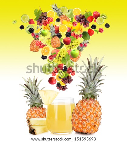 Diffferent fruits and berries falls into glass of fresh juice, on yellow background - stock photo