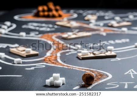 Difficult labyrinth to find the sweet treasure - stock photo