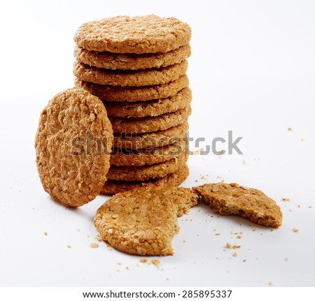 Digestive oat biscuits in a stack over white background - stock photo