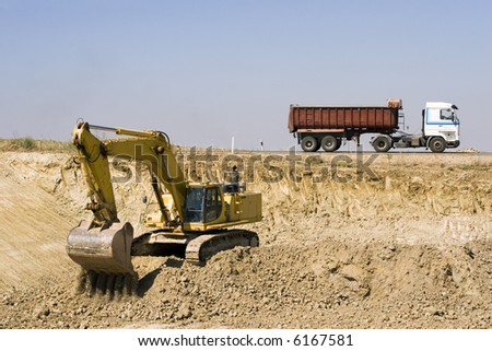 Digger and truck - stock photo