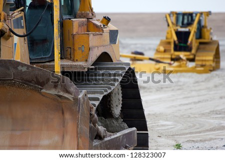 Digger or Bulldozer at work site - stock photo