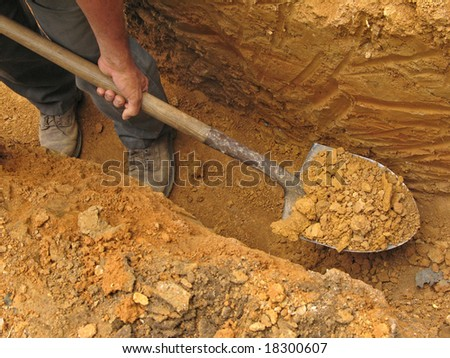 Digging a trench - stock photo