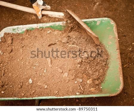 Digging mud - stock photo
