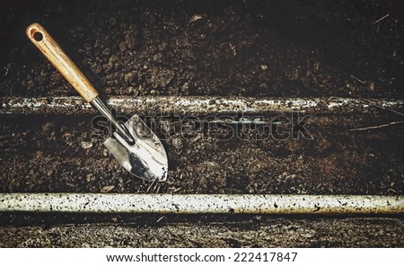 digging soil for repairing pipes under the ground - stock photo