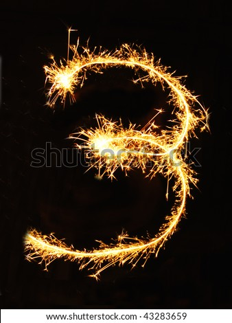 Digit 3 made of sparklers - stock photo