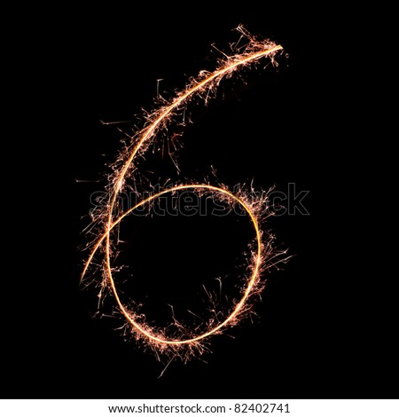 Digit 6 made of sparklers isolated on black. Real sparkler alphabet - stock photo