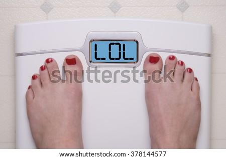 Digital Bathroom Scale Displaying LOL text - stock photo