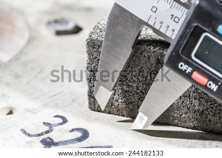Digital calliper and cutting and grinding disks with diamonds. - stock photo