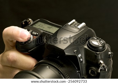 Digital Camera With Finger Pressing The Shutter Button - stock photo
