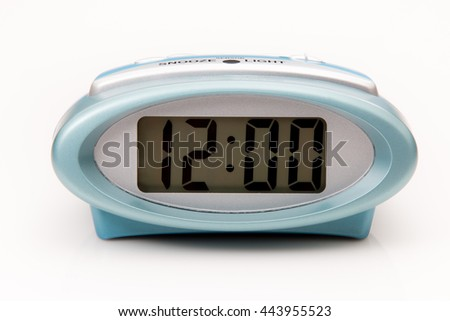 Digital clock displaying 12:00 o'clock on a white background - stock photo