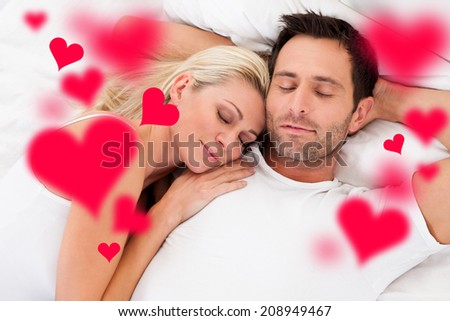 Digital composite image of loving young couple sleeping in bed - stock photo