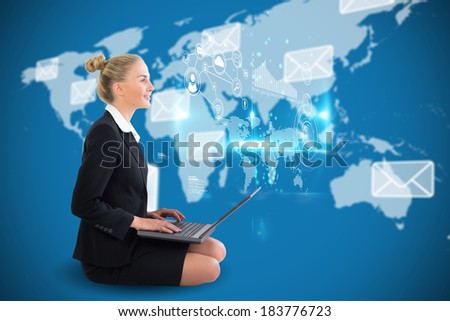 Digital composite of blonde businesswoman sitting using laptop with earth interface - stock photo