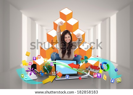 Digital composite of cheering girl using laptop with app icons - stock photo