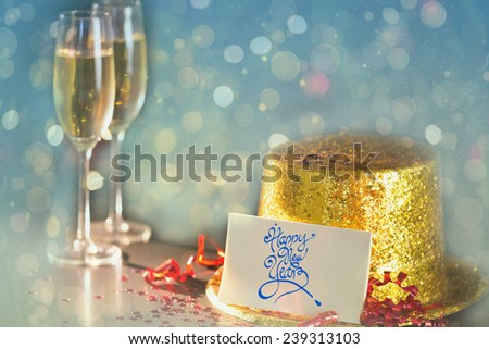 Digital composite of Happy new year card leaning on gold party hat - stock photo